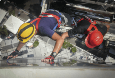 two workers are suspended as they work outside of a high rise building