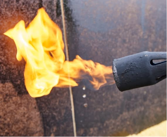 working with a propane blow torch
