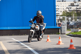 A motorcyclist takes a driving test after completing his online motorcyclist safety course