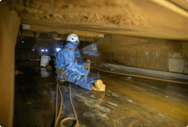 A trapped worker waits to be rescued from a confined space