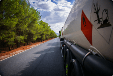 A truck carrying dangerous goods drives on the road