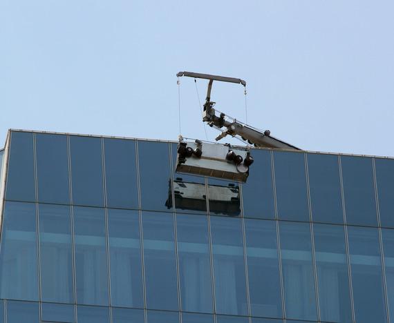 window washers on platform suspended