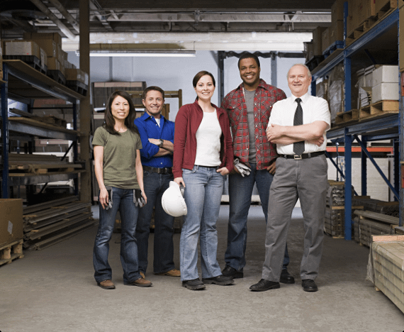 Workers in a safe workplace pose for a photo together