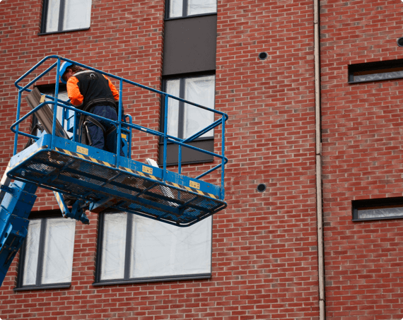 A worker on an aerial lift