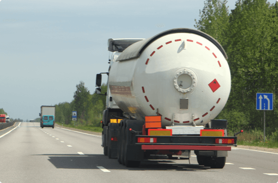 A truck carrying dangerous materials drives on the highway
