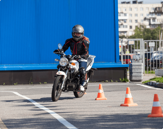 A woman taking motorcycle safety training courses