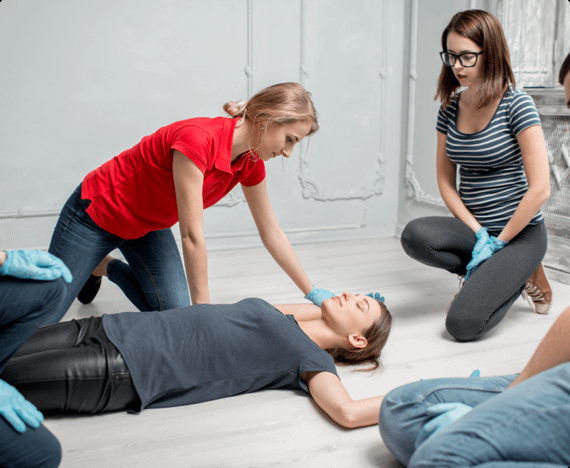employees practicing CPR on their coworker