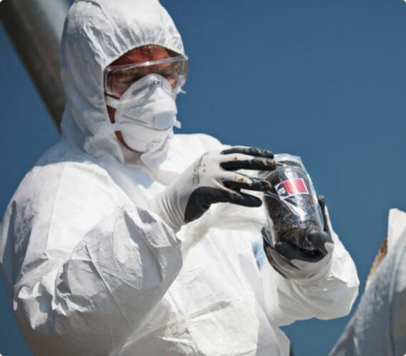 An environmental inspector takes a sample