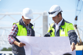 A manager and supervisor go over site plans to ensure safety