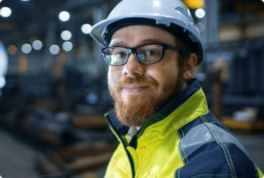 A member of a joint health and safety committee smiles at the camera