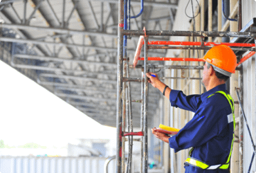 A man inspects a scaffold after receiving his scaffold certification