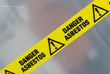 Safety tape warning of asbestos