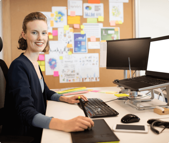 a woman works at an ergonomically friendly desk